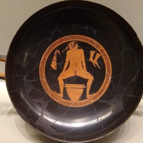 Hetaera urinating into a skyphos at a Kylix