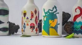 Оригинальные бутылки крафтового оливкового масла Heraia с красочными иллюстрациями на основе древних мифов