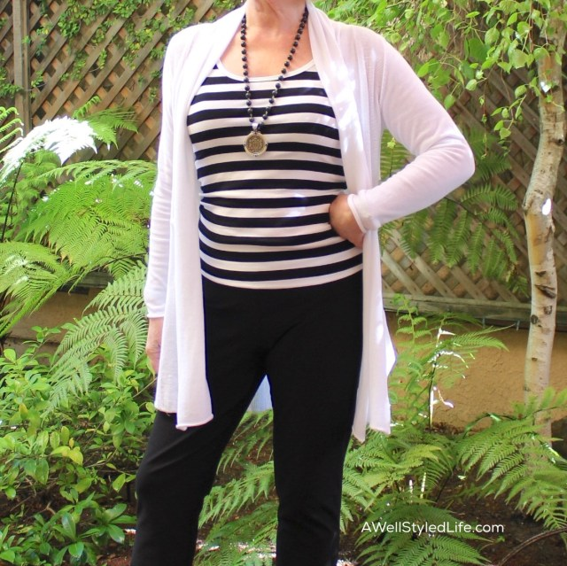 Sideways stripes do not add weight to your look when you wear a tunic to cover the outsides of your body.