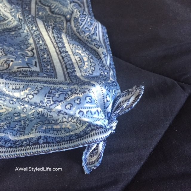 Square knot is corners of silk scarf