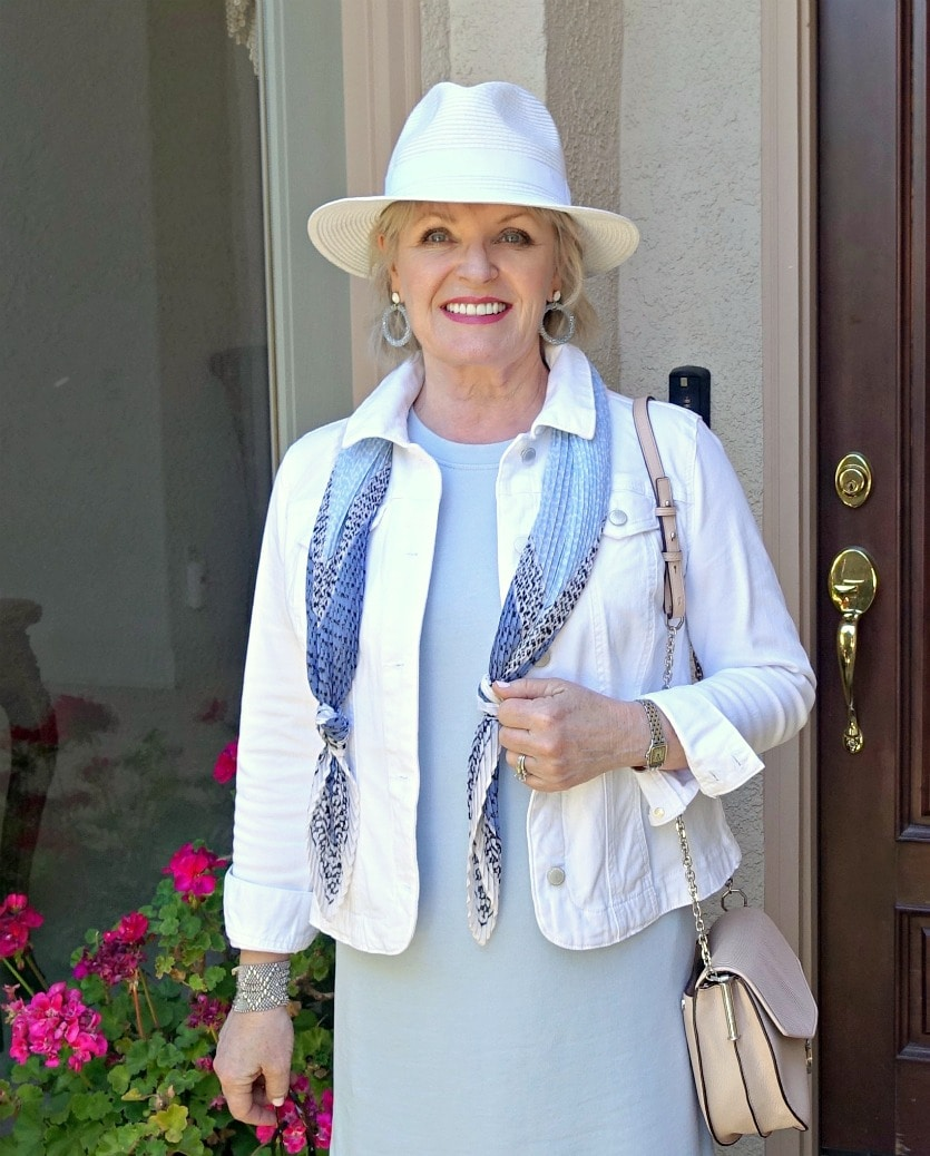 Jennifer Connolly of A Well Styled Life wearing summer dress from Loft and white denim jacket from Macy's