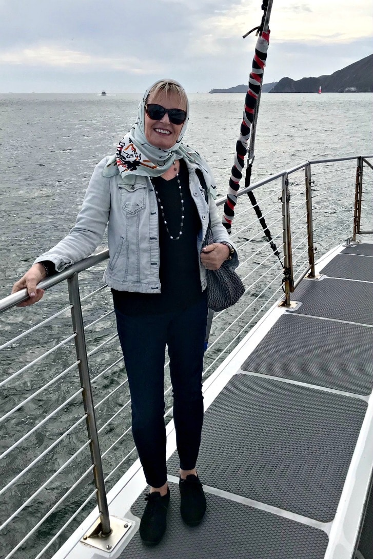 Wearing Talbots limited edition scarf to protect hair while sailing