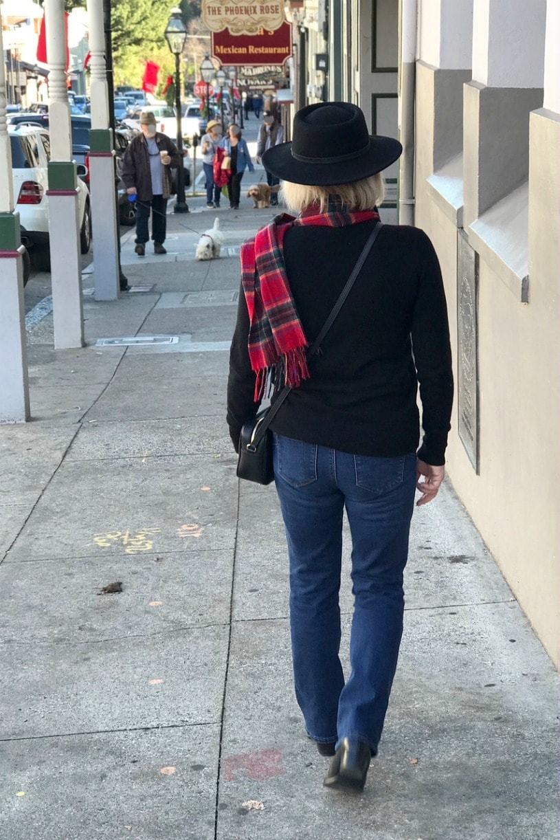 Jennifer Connolly of A Well Styled Life wearing plaid scarf and black fedora in Nevada City