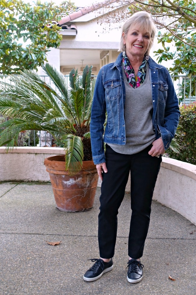styling a sweater and jeans with denim jacket a neck scarf