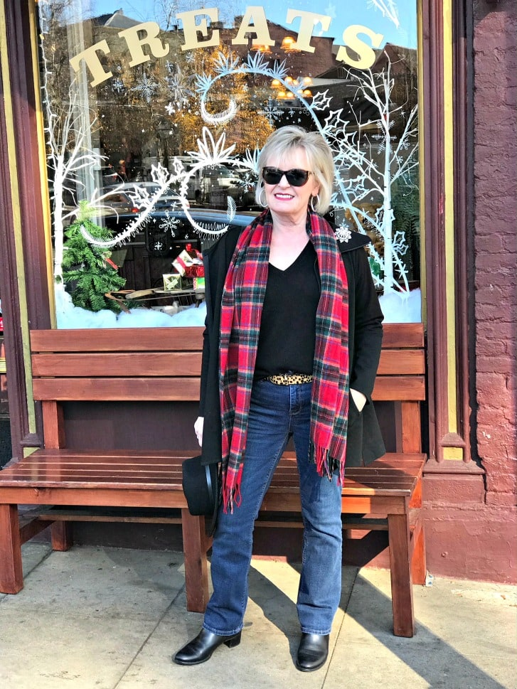 Jennifer Connolly of A Well Styled Life wearing Talbots plaid scarf with black sweater and hat
