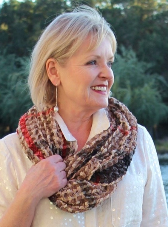 Jennifer Connolly of A Well Styled life showing how textured scarf can smooth the lines on your face