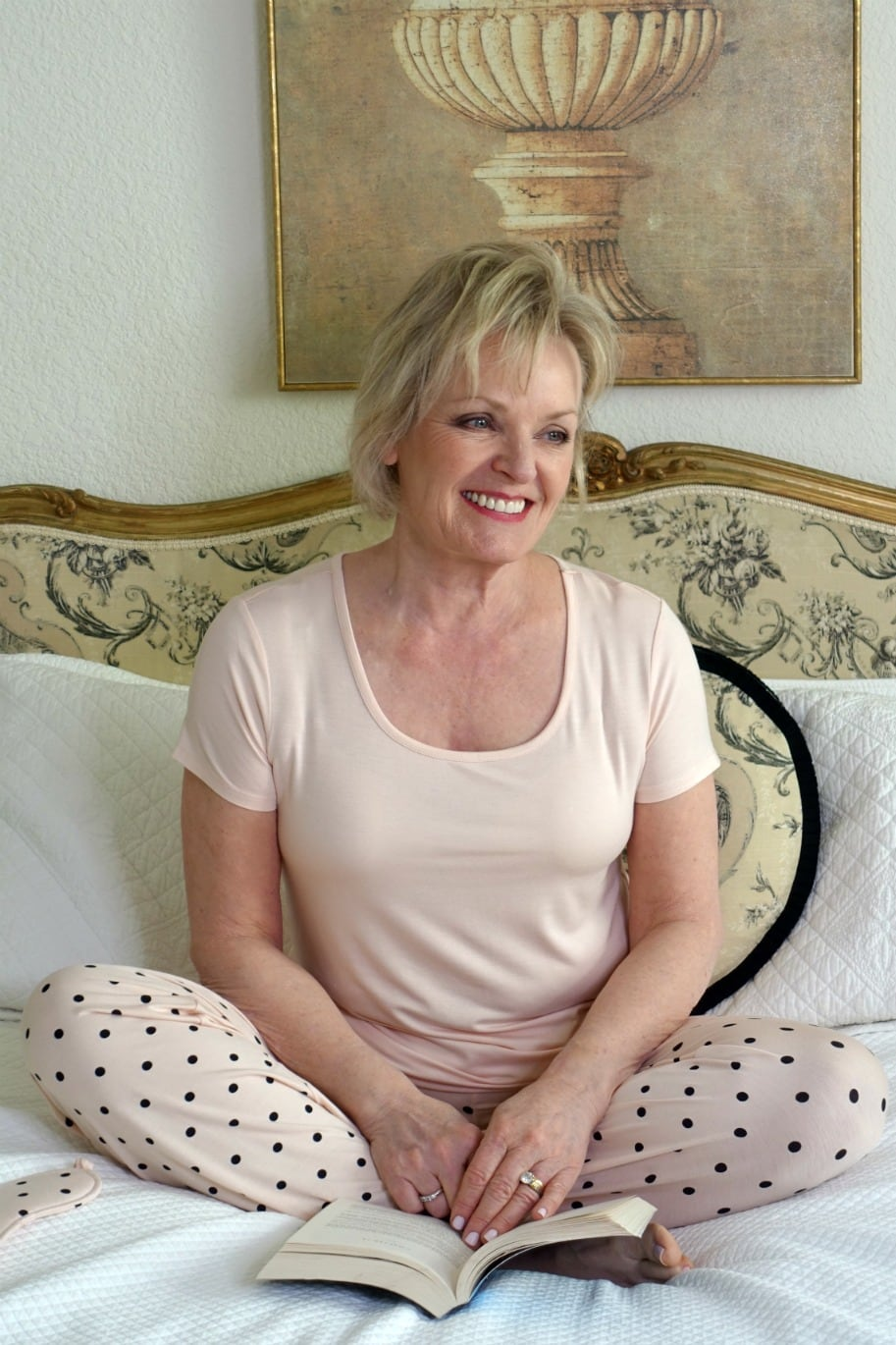 Jennifer of A Well Styled Life wearing Soma's Cool Nights Pajama set in peach Dot