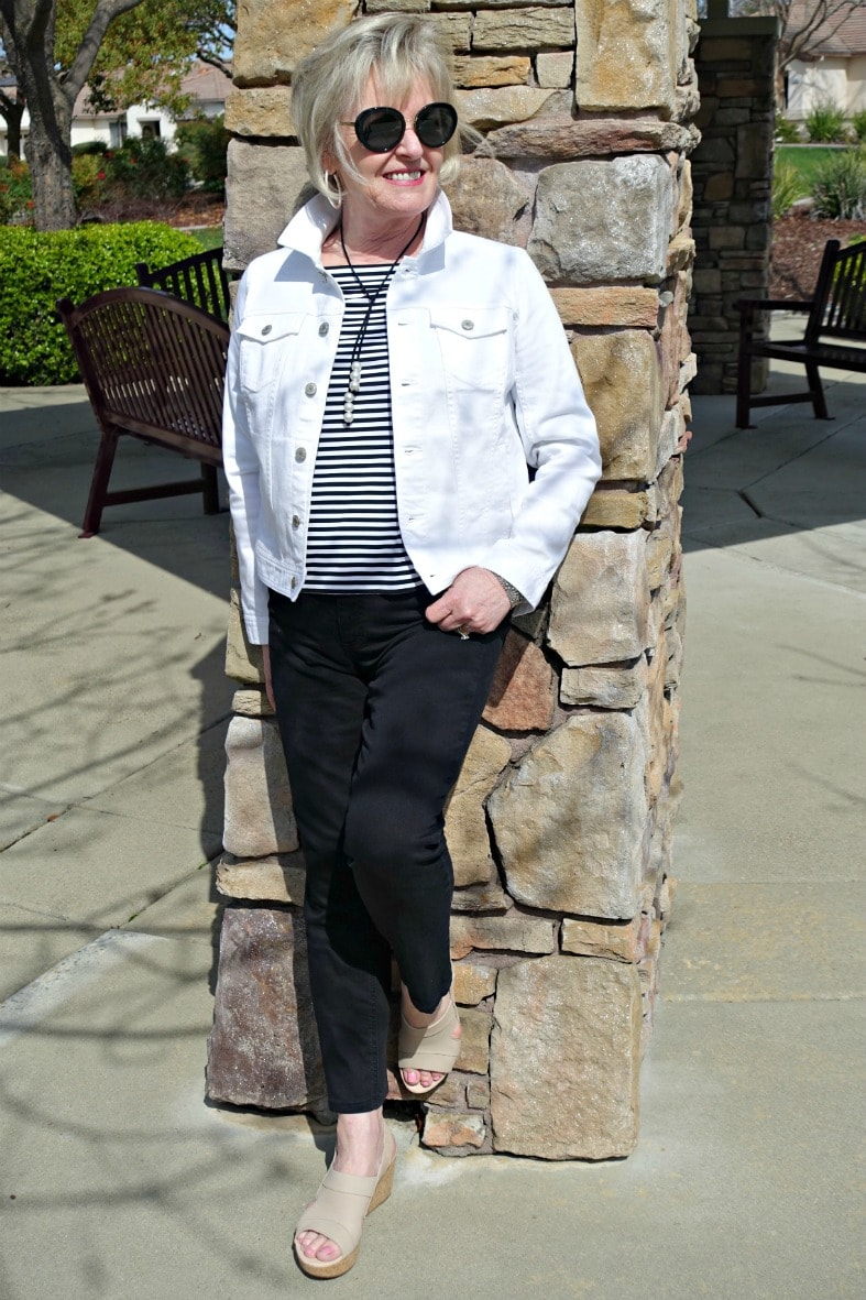 Jennifer Connolly of A Well Styled Life wearing Clarks Annadel Ivory wedge sandal with black jeans, white denim jacket and striped top