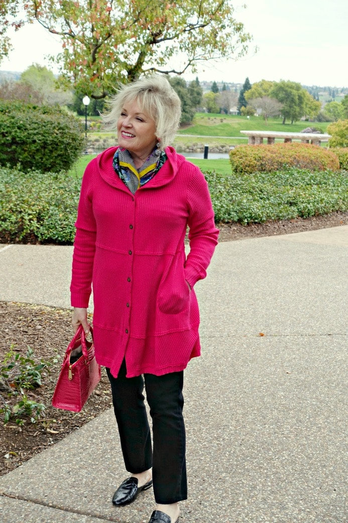 Jennifer Connolly of A Well Styled Life wearing pink hoodie from Artful Home over black jeans and black mules