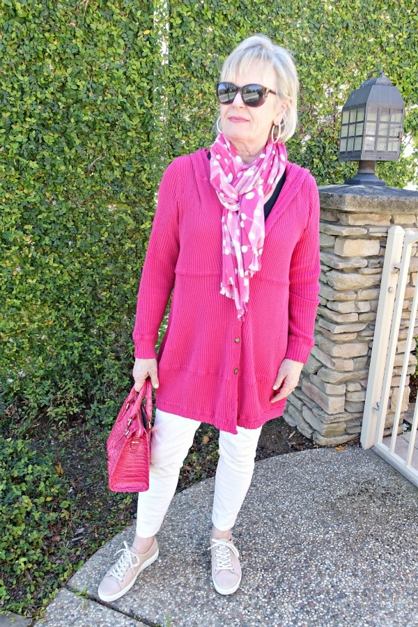 Jennifer Connolly wearing a casual outift of pink hoodie, pink jeans, pink sneakers and pink scarf
