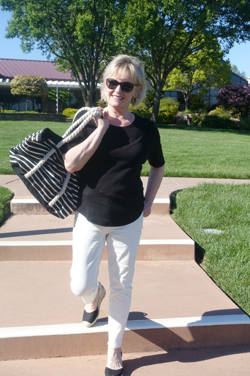 black and cream striped tote bag from Walmart styled with black tee and cream colored jeans on Jennifer from A Well Styled Life