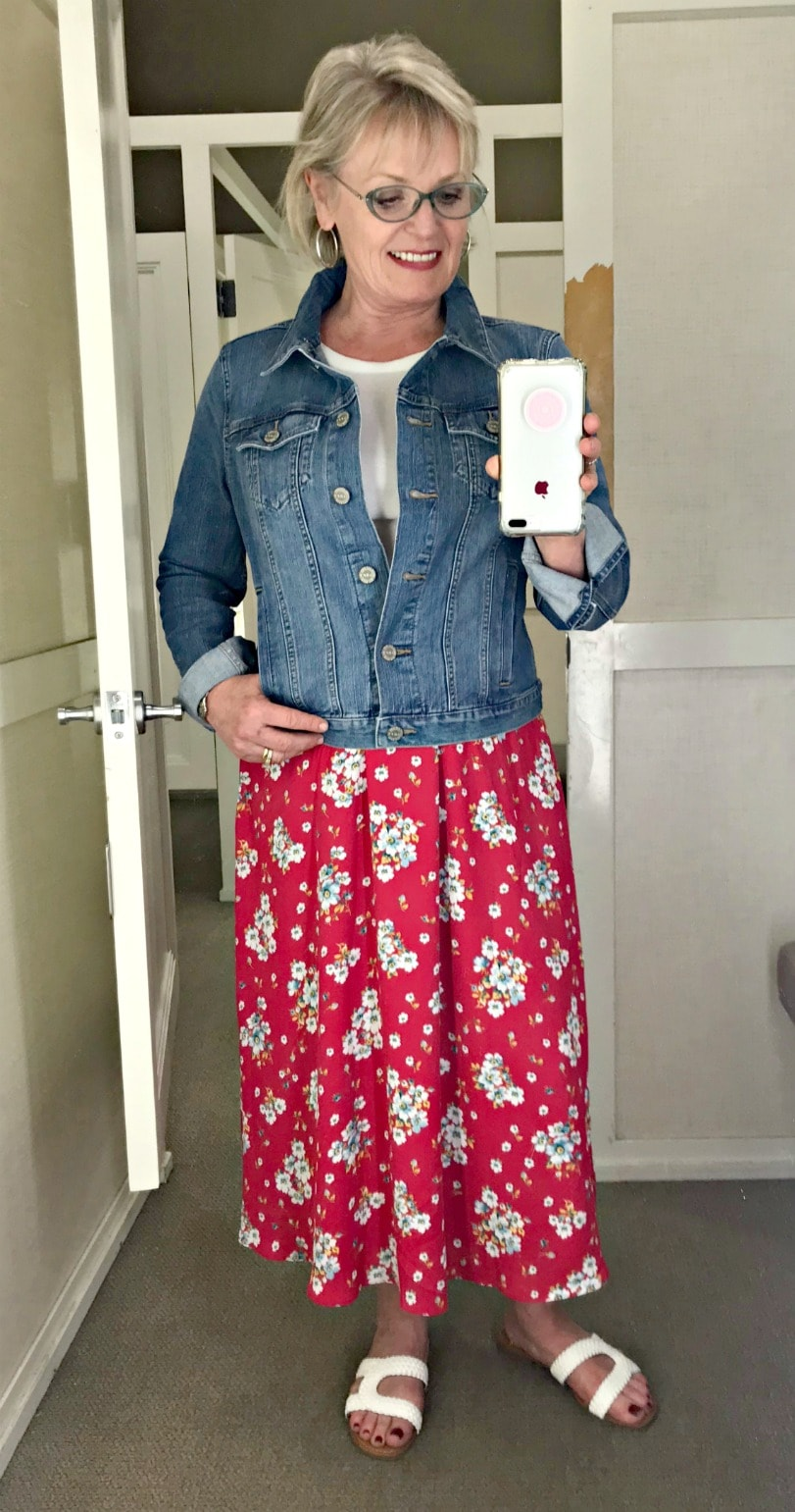 Jennifer Connolly of A Well Styled Life wearing floral skirt with denim jacket from Loft