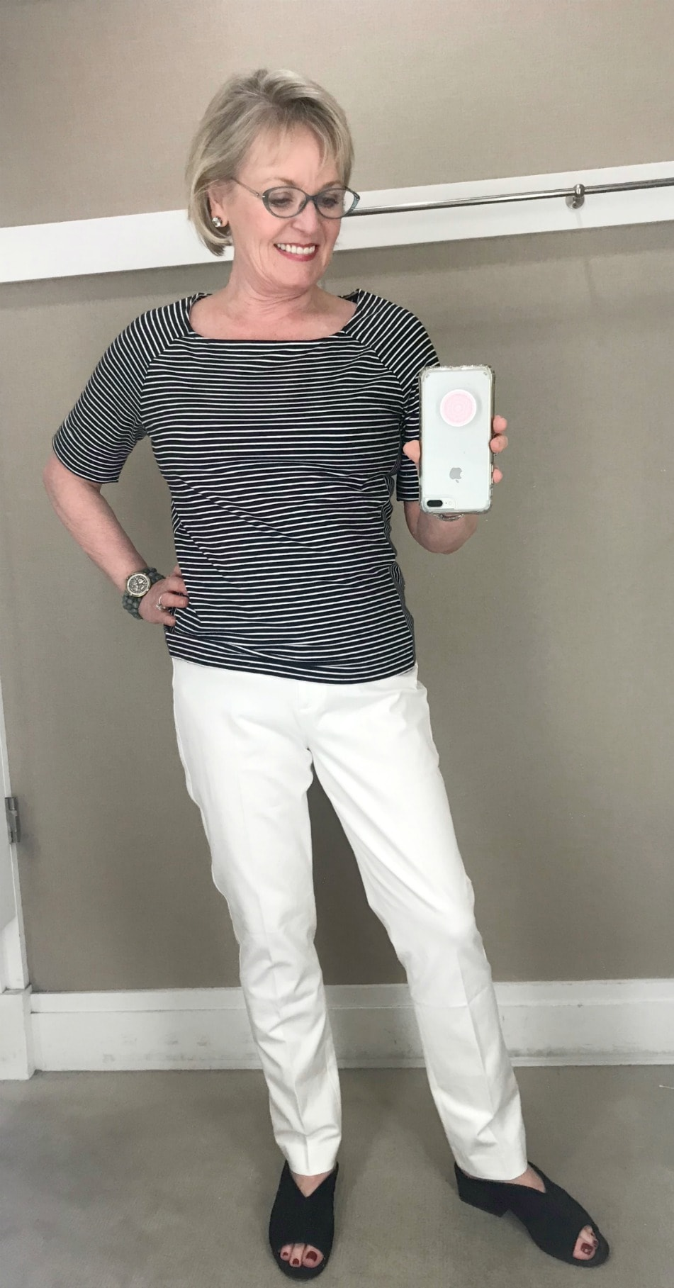 Jennifer Connolly of A Well Styled Life wears a striped tee and slim linen pant from Talbots