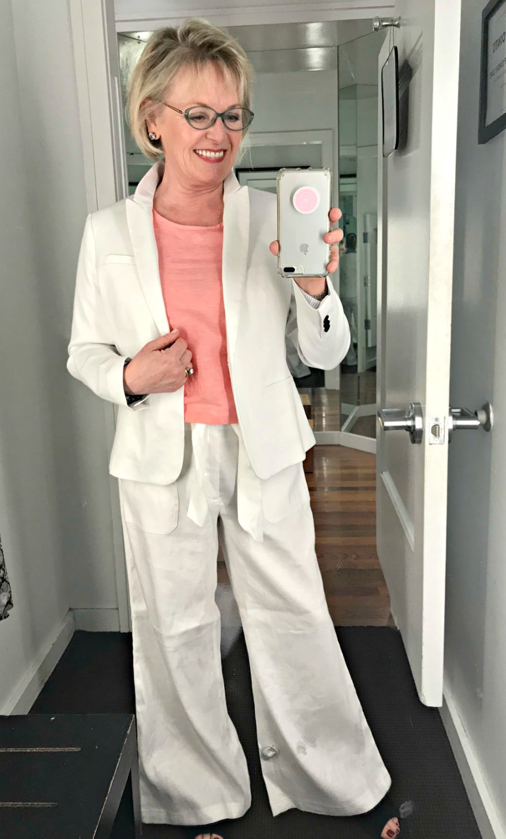 Jennifer Connolly of A Well Styled Life styling a white linen suit in Banana Republic