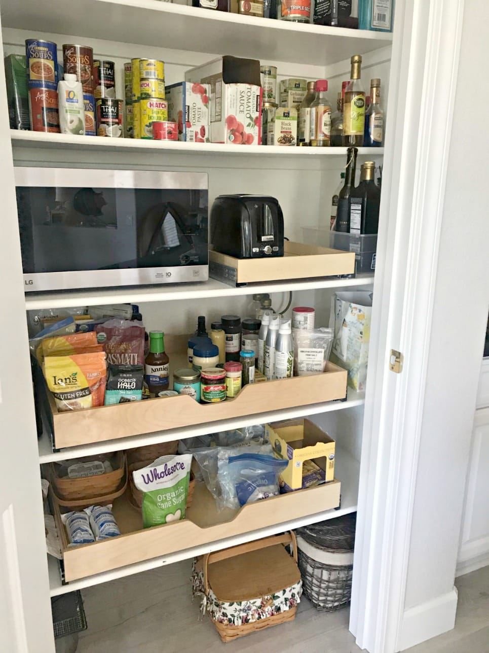 pantry after renovation with pull out shelves on A Well Styled Life