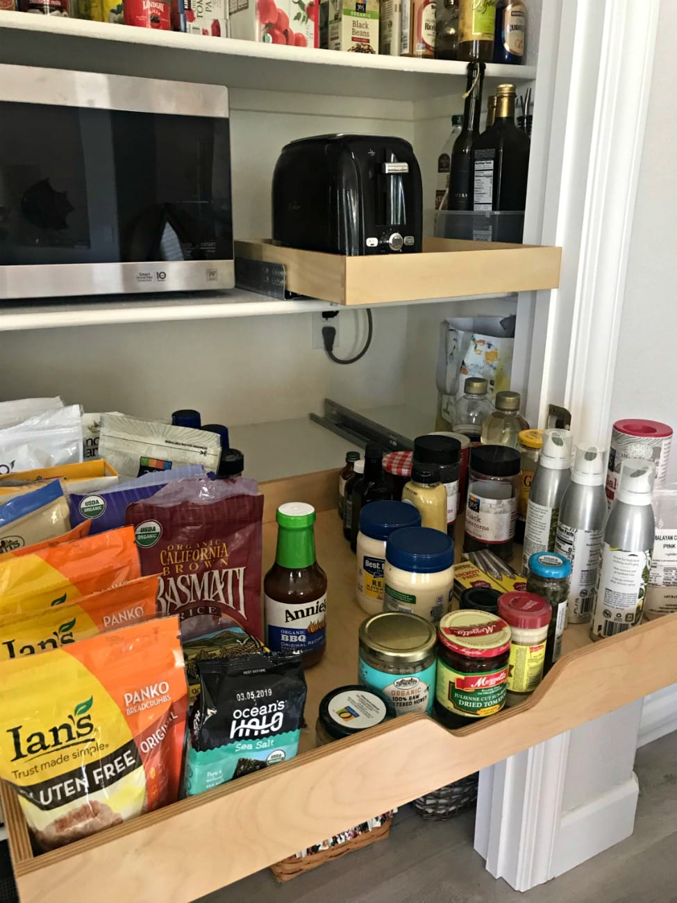 soft close pullout shelves for toaster and dry goods in pantry on A Well Styled Life