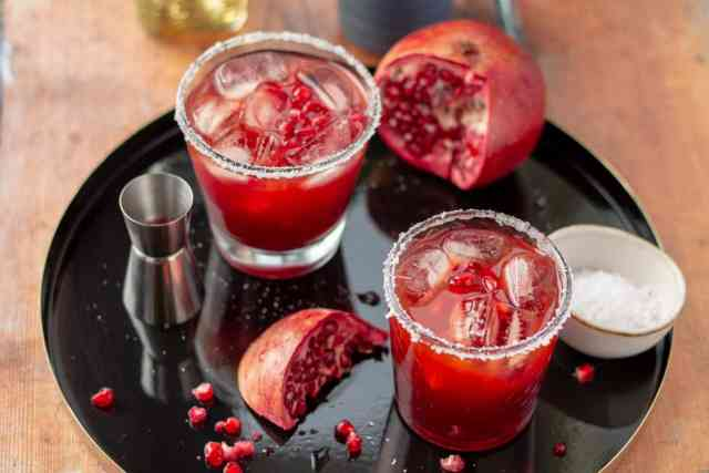 Pomegranate Margarita with an open pomegranate