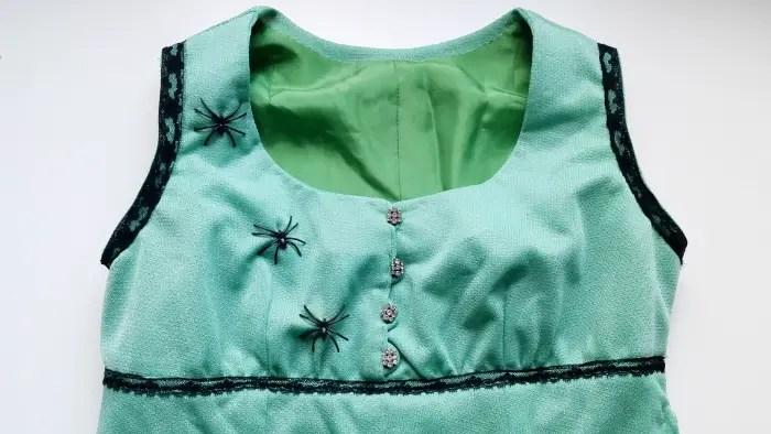 Refashioned vintage dress with spider embellishments