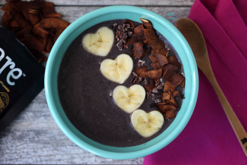 Acai Protein Smoothie Bowl with chocolate coconut chips, cacao nibs, and bananas. (vegan and gluten free)
