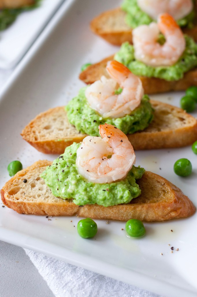 Crostini with Fresh Pea Pesto with shrimp , A Whisk and Two Wands