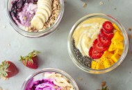 3 yogurt bowls, mango, strawberries, blackberries, pitaya, mango, granola, bananas, chia