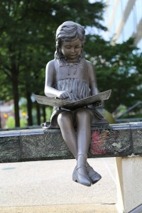Statue of young girl reading a book