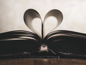 Book with pages bent in a heart shape