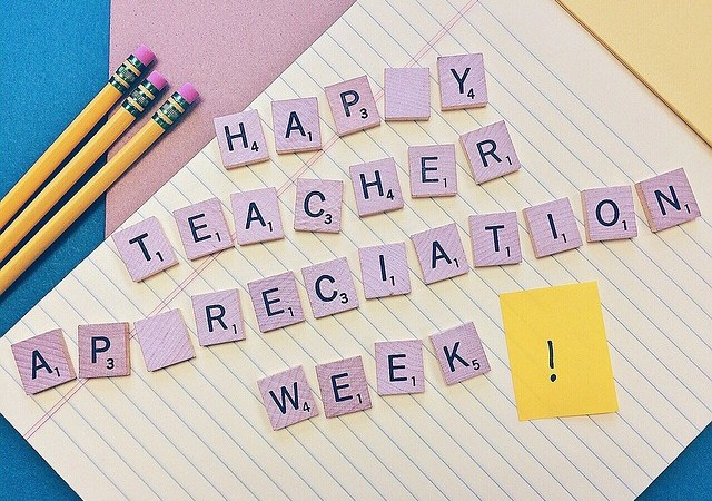Scrabble board aand letters spell Happy National Teacher Appreciation Week