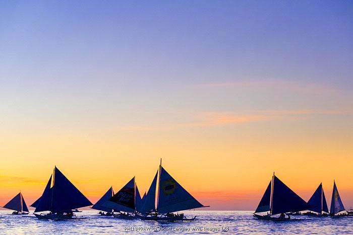 Sailboats at sunset on White Beach, Boracay Island, Aklan Province, Western Visayas, Philippines