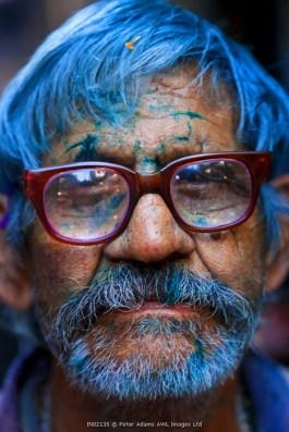 Man covered in Holi powder, Holi Festival, Mathura, Uttar Pradesh, India