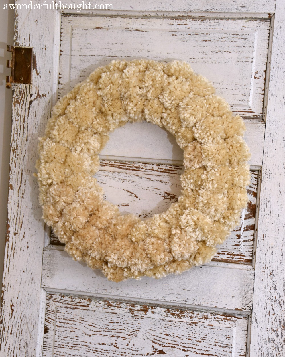 DIY Winter Pom Pom Wreath | awonderfulthought.com