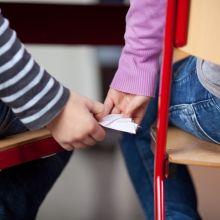 School Girls Passing Notes