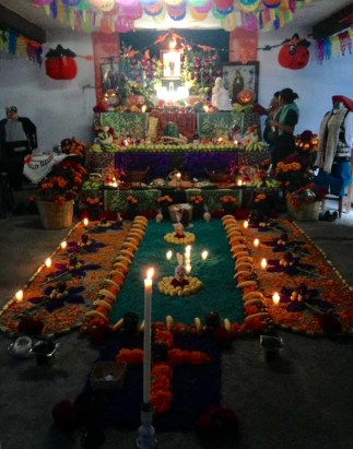 An ofrenda to a woman who recently passed in my friend's house