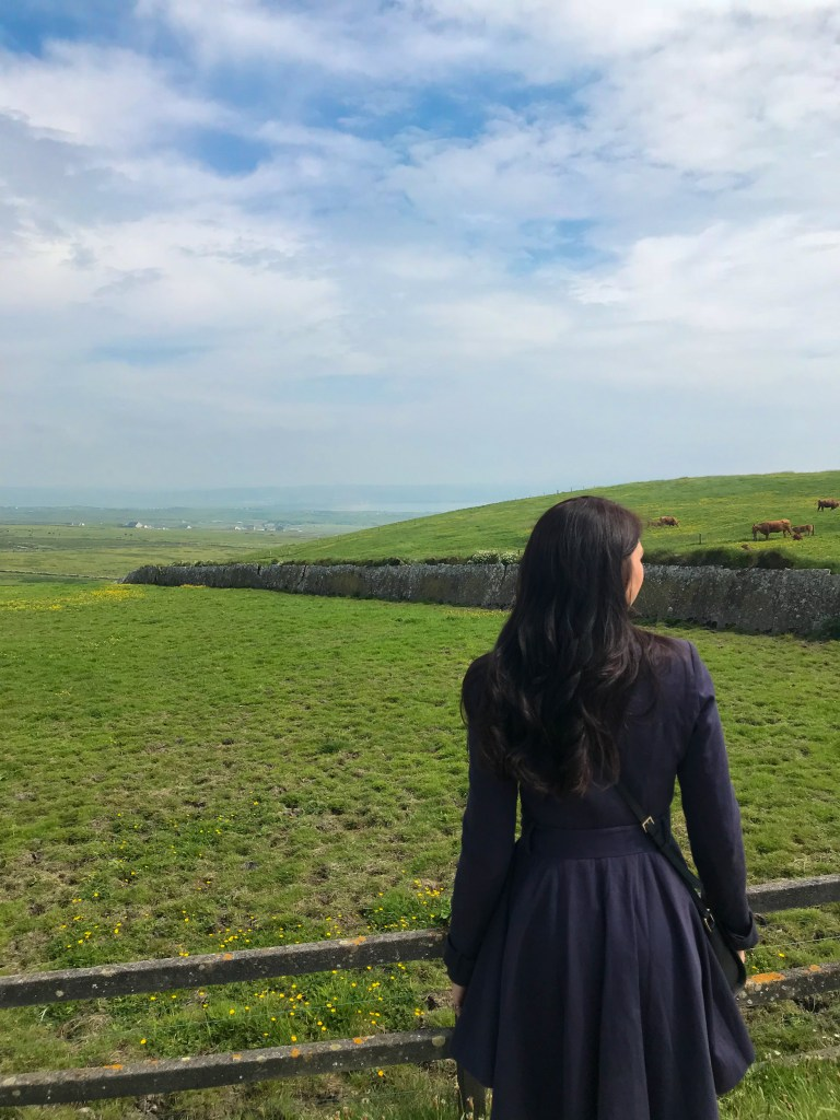 Woman staring at Irish landscape