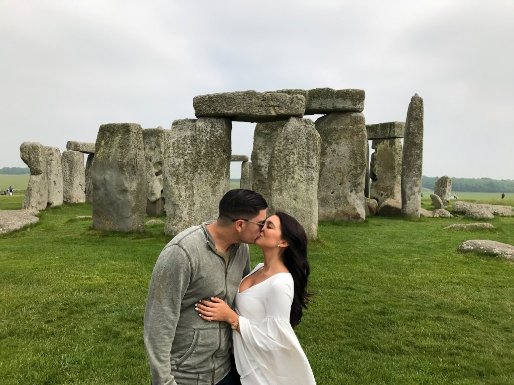 Man and woman kissing at Stonehenge, England