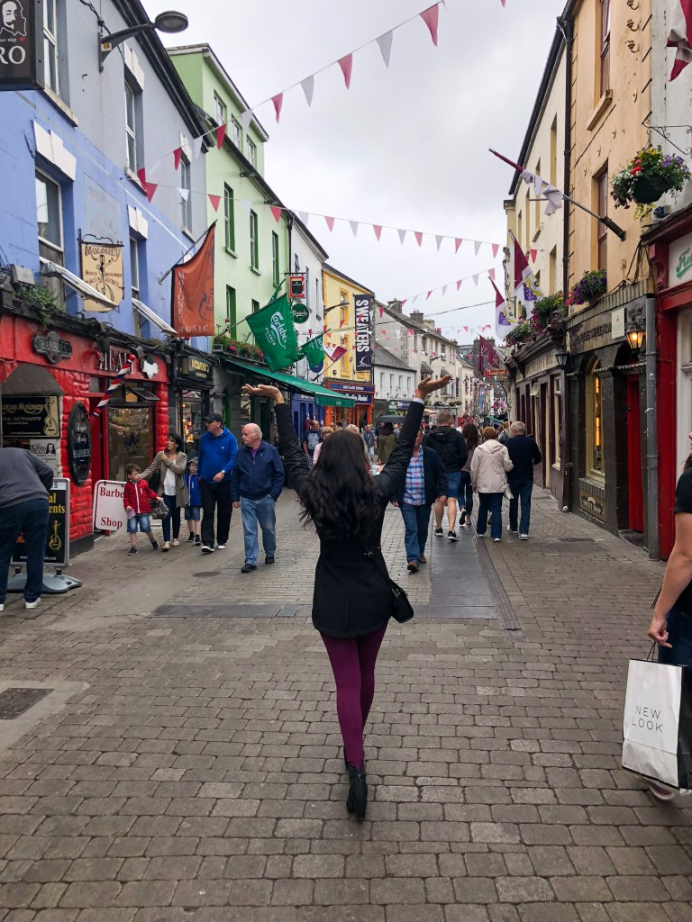 woman walking through Galway, Ireland
