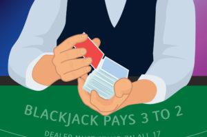 dealer memegang dengan satu tangan dan menempatkan kartu potong merah di dekat ujung dek dengan tangan lainnya