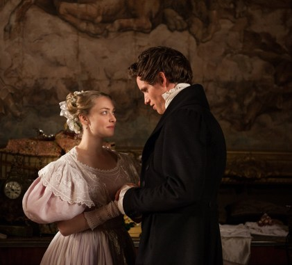Amanda Seyfried as Cosette and Eddie Redmayne as Marius Pontmercy, Les Misérables (2012)