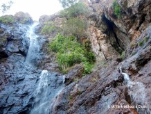 Looking up the cascades of Wangi Falls