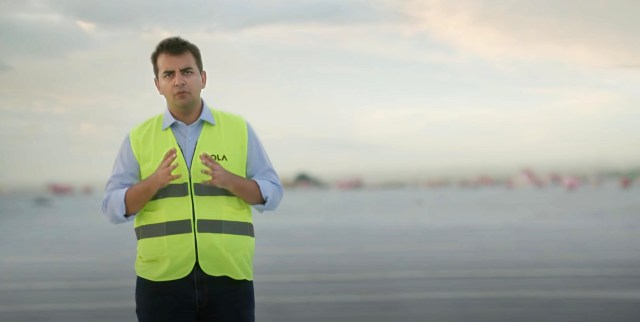 Bhavish Aggarwal, CEO of Ola Mobility Pvt. Ltd, on the roof of his new Gigafactory