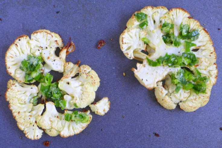 Roasted cauliflower steaks with scallion dressing