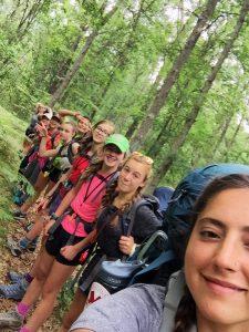 Trailblazer girls smile during backpacking trip