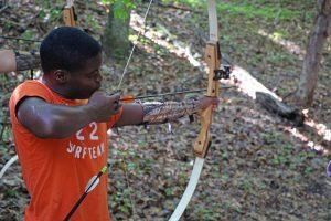 Camper aims arrow at archery