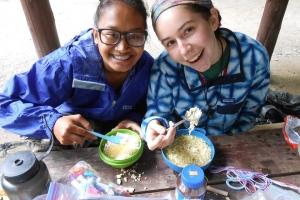 Merrowvista summer camp Odyssey women smile during mealtime