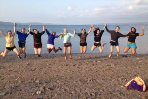 Merrowvista summer camp Voyageur women jump at beach