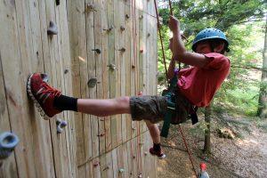 Challenger traverses climbing wall