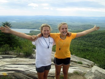 Camp Merrowvista Trailblazer campers celebrate on mountain top during backpacking trip