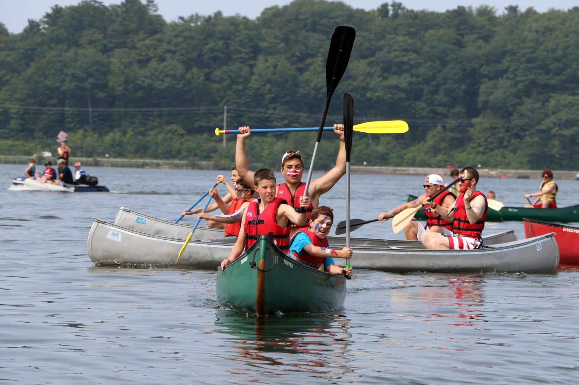 Camp Miniwanca Trailblazers in canoe wave paddles in celebration
