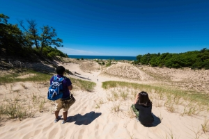 Camp Miniwanca staff and student look at Lake Michigan from top of dune- photo courtesy Dan Terpstra-min