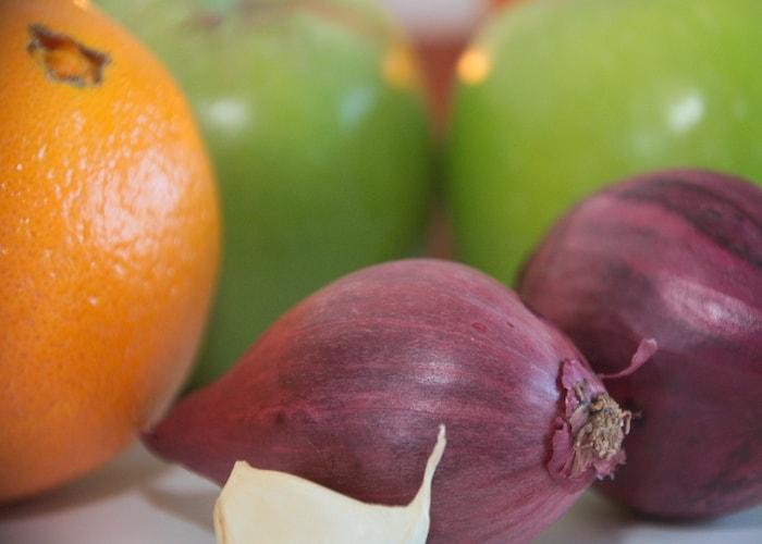 Ingrediënten pompoensoep ui knoflook sinaasappel appel